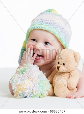 Funny Baby Boy Lying On Bed With Plush Toy