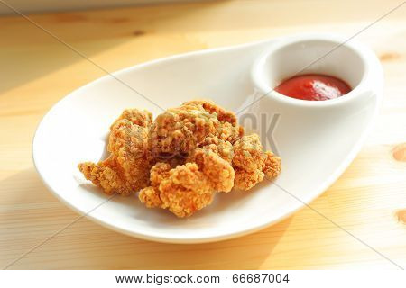 Deep fried chicken with ketchup