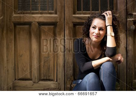 Thoughful woman in urban background