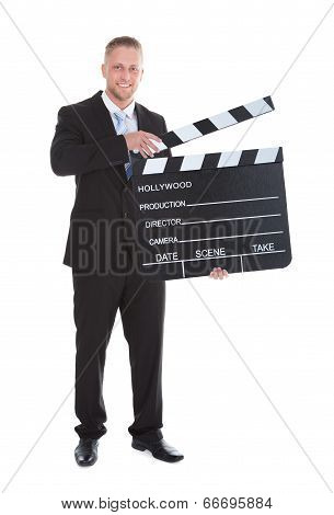 Businessman Holding A Blank Clapper Board With The Arm