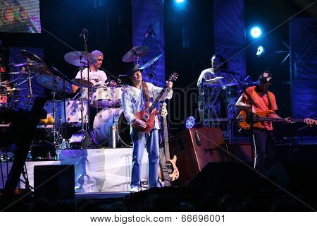 ATLANTIC CITY, NJ - JUNE 13: Musician Carlos Santana performs with his band at The Borgata Hotel & Casino on June 13, 2014 in Atlantic City, NJ.