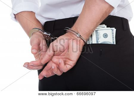 Man In Handcuffs With Banknotes In His Pocket