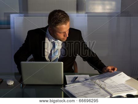 Businessman Under Pressure Working Overtime