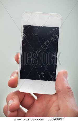 Businessman Holding A Damaged Smartphone