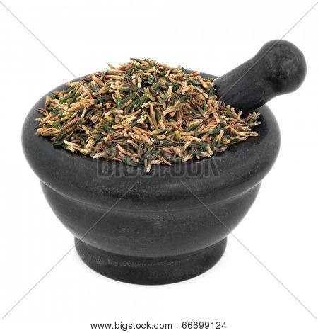 Lotus flower plumule chinese herbal medicine in a black stone mortar with pestle over white background. Lian zi xin.