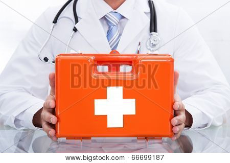 Smiling Doctor Or Paramedic With A First Aid Kit