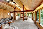 picture of log cabin  - Open floor plan in log cabin house - JPG