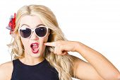 stock photo of shock awe  - Crazy isolated portrait of a shocked blonde woman wearing sunglasses with pin - JPG
