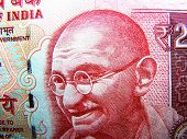 stock photo of gandhi  - mahatma gandhi known as father of india nation on indian rupee currency - JPG