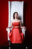 stock photo of throne  - princess woman in a red dresssitting on throne - JPG