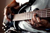 foto of chimney rock  - Close up photo playing five string bass guitar  - JPG