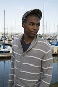stock photo of newsboy  - black male model wearing sweater newsboy hat - JPG