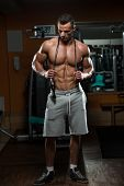 stock photo of cardio exercise  - Handsome Muscular Man With Jumping Rope  - JPG