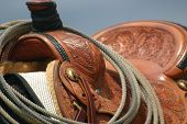 stock photo of western saddle  - Homemade Leather saddle wating to be rode at a branding in Montana - JPG