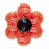 picture of licorice  - a black licorice wheel on some red licorice wheel on a white background - JPG