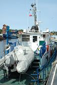 foto of pontoon boat  - Pontoon and other devices on small fishing vessel deck - JPG