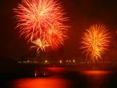 stock photo of reveillon  - beautiful fireworks celebrating new year on the beach - JPG