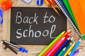 foto of pencils  - black chalk  board with back to school and colorful school supplies - JPG