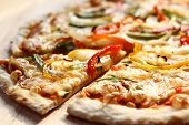 image of italian food  - Roasted vegetable Pizza. Italian style thinly pizza crust on wood board