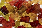 stock photo of gummy bear  - some colorful gummy bears in light back - JPG