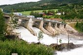 image of hydroelectric power  - Huge amounts of water flowing in the river near the Hunderfossen hydroelectric power station in Norway - JPG