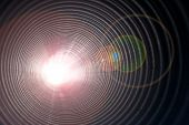stock photo of hallucinogens  - light at the end of the tunnel pipe concept with glowing lens flare - JPG