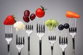 picture of root vegetables  - Fruit and vegetable of silver forks against a grey background concept for healthy eating - JPG