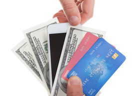 image of payment methods  - Hand holding banknotes credit cards and a tablet with a second hand selecting the tablet as a method of purchase and payment for merchandise isolated on white - JPG