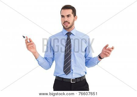 Businessman holding marker and gesturing on white background