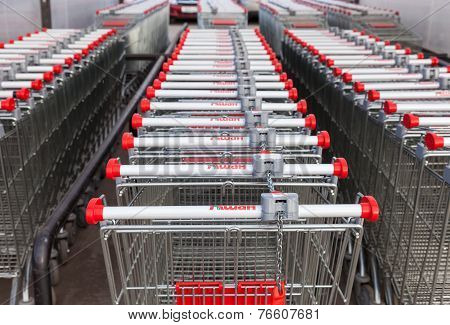 Samara, Russia -  November 16, 2014: Large Empty Red Shopping Cart Auchan Store. French Distribution