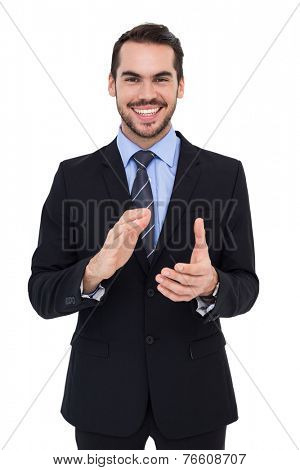 Happy businessman standing and applauding on white background