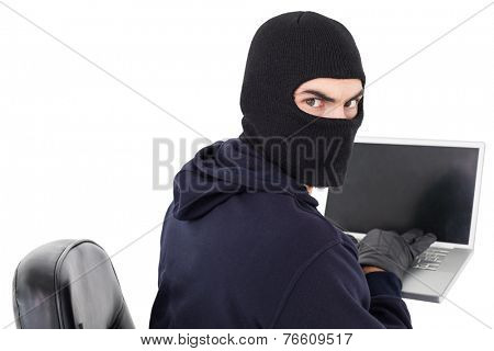 Hacker sitting and hacking laptop on white background
