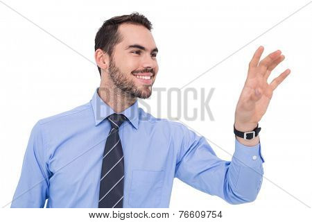 Happy businessman catching something with his hand on white background