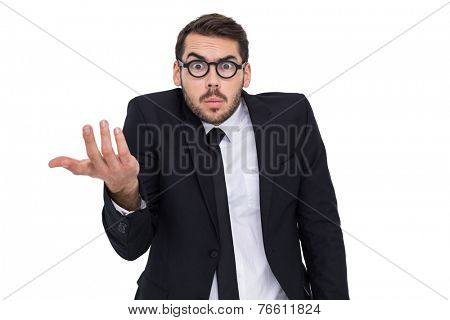 Doubtful businessman with glasses gesturing on white background