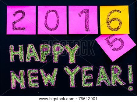 Happy New Year 2016 message hand written on blackboard