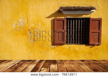 Opened-window on yellow wall and wood floor
