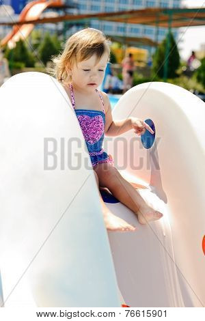 Toddler On The Water Slide