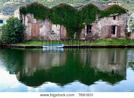 House And Boat On The River