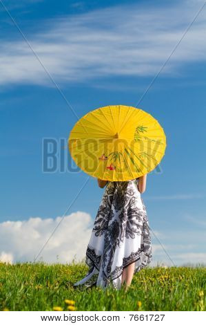 Girl With Parasol Looking Away In Spring