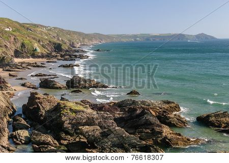 Looking Across The Beach At Whitesand Bay In Cornwall Towards The Rame Head Headland