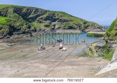 Fishing boats pulled up Port Isaac harbour waiting for the next tide.