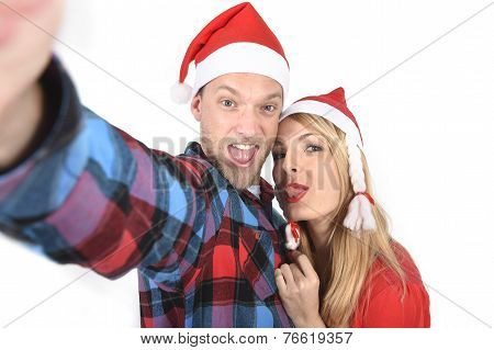 Young Romantic Couple In Love Taking Selfie Mobile Phone Photo At Christmas
