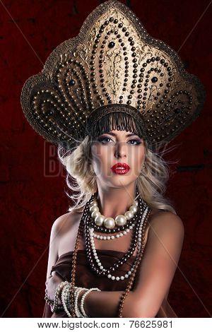 Russian Beauty. Attractive female wearing in kokoshnik. Woman's headdress in old Russia