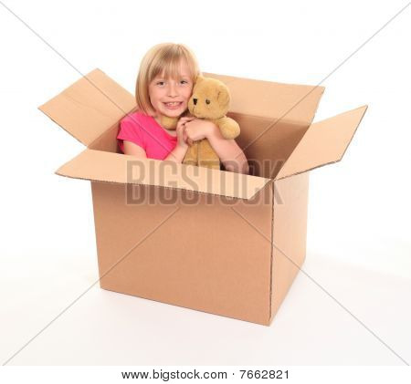Young Little Girl Sitting Inside Box