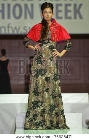 NOVOSIBIRSK, RUSSIA - NOVEMBER 15, 2014: Model on the Grand defile of Novosibirsk Fashion Week. The event was held under the motto High Fashion & High Classics