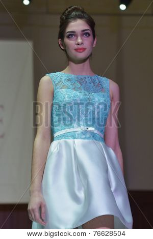 NOVOSIBIRSK, RUSSIA - NOVEMBER 15, 2014: Model dressed from Pauline collection on the Grand defile of Novosibirsk Fashion Week. The event was held under the motto High Fashion & High Classics