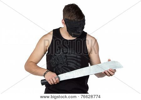 Photo of young man in mask with hatchet