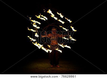 BALI, INDONESIA - NOVEMBER 20, 2014: Fire dancer with traditionnal costume , BALI, INDONESIA on NOVEMBER 20, 2014