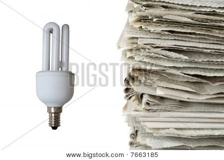 Light Bulb And Used Newspapers
