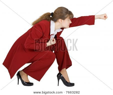 Businesswoman In Combat Position On White